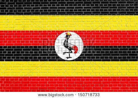 Ugandan national official flag. African patriotic symbol banner element background. Flag of Uganda on brick wall texture background, 3d, illustration