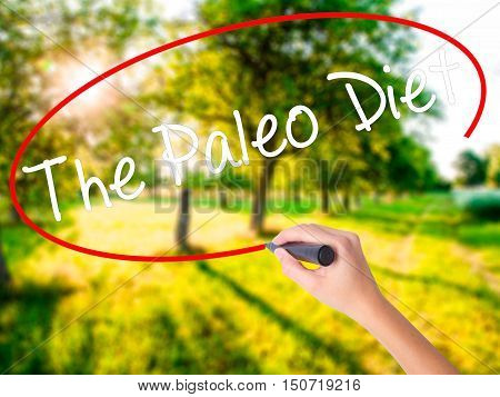 Woman Hand Writing The Paleo Diet With A Marker Over Transparent Board