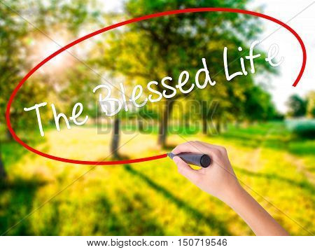 Woman Hand Writing The Blessed Life  With A Marker Over Transparent Board .