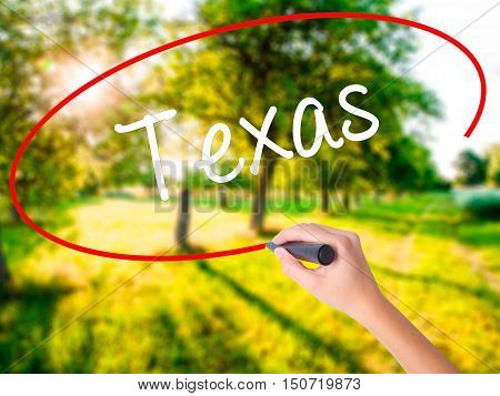 Woman Hand Writing Texas  With A Marker Over Transparent Board