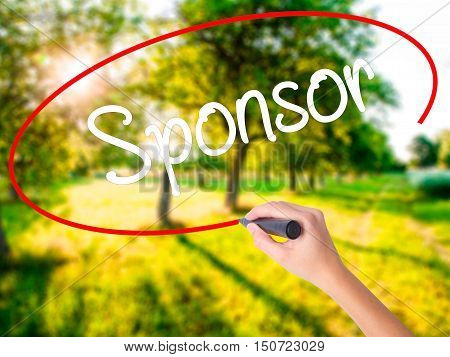 Woman Hand Writing Sponsor With A Marker Over Transparent Board