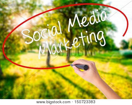 Woman Hand Writing Social Media Marketing With A Marker Over Transparent Board