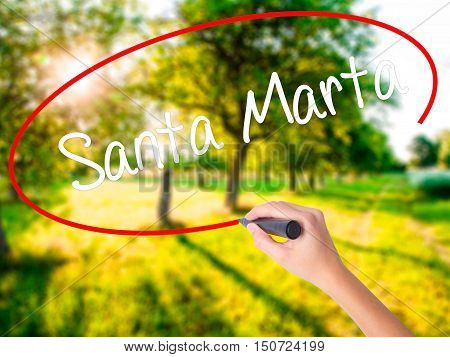 Woman Hand Writing Santa Marta With A Marker Over Transparent Board
