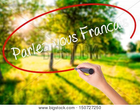 Woman Hand Writing Parlez-vous Fran�§ais?(do You Speak French? In French)  With A Marker Over T