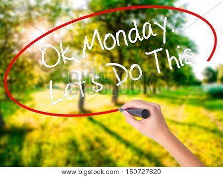 Woman Hand Writing Ok Monday
