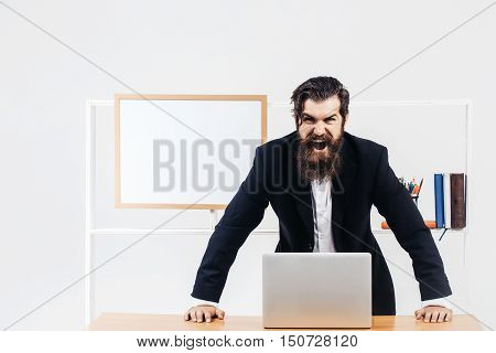 Angry Workman Learning Over Table
