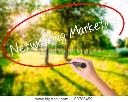 Woman Hand Writing Networking Marketing With A Marker Over Transparent Board