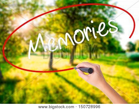 Woman Hand Writing Memories With A Marker Over Transparent Board