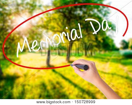 Woman Hand Writing Memorial Day With A Marker Over Transparent Board .
