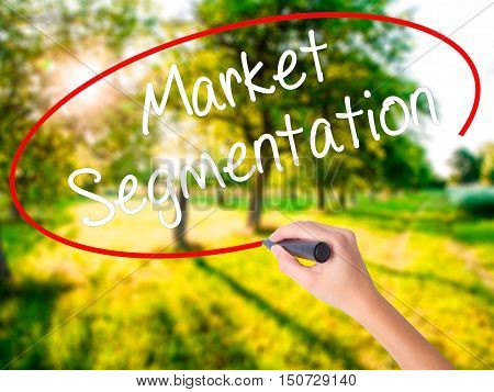 Woman Hand Writing Market Segmentation With A Marker Over Transparent Board .