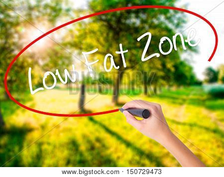 Woman Hand Writing Low Fat Zone With A Marker Over Transparent Board