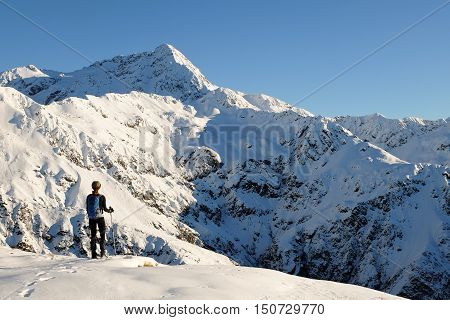 A Woman Hiker on Avalanche Peak Looks to Mt Rolleston. Arthurs Pass, Southern Alps, Canterbury, New Zealand
