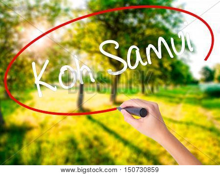 Woman Hand Writing Koh Samui With A Marker Over Transparent Board
