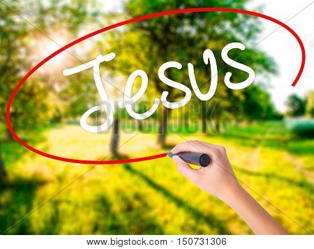 Woman Hand Writing Jesus  With A Marker Over Transparent Board