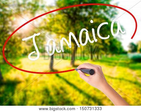 Woman Hand Writing Jamaica  With A Marker Over Transparent Board