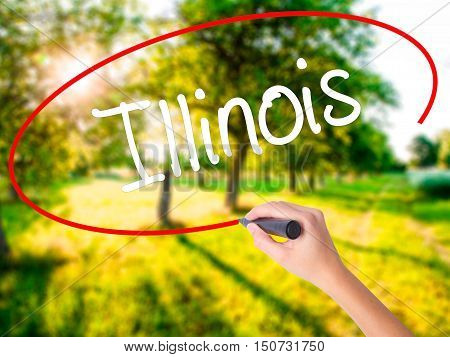 Woman Hand Writing Illinois With A Marker Over Transparent Board