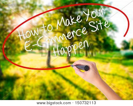 Woman Hand Writing How To Make Your E-commerce Site Happen With A Marker Over Transparent Board .