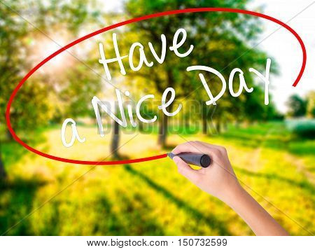 Woman Hand Writing Have A Nice Day With A Marker Over Transparent Board