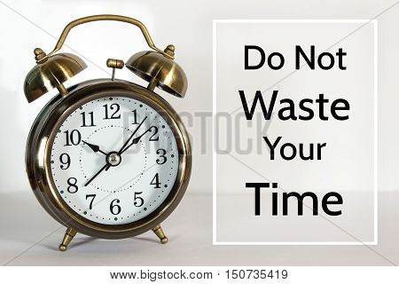 Do not waste your time, message on the clock background / Time concept