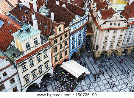 PRAGUE, CZECH REPUBLIC - MAY 2015: Prague Old Town Square with colorful old buildings and crowd of tourists in Czech Republic, view from above.