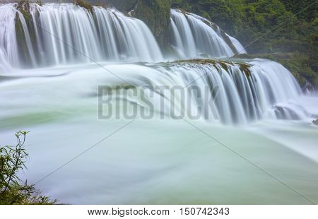 Ban Gioc Waterfall shimmering silk sheet honoring scenic beauty of Vietnam most beautiful waterfalls. It is rugged border region had known as tourist attraction