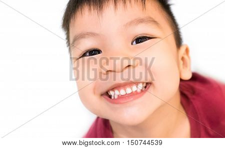 Asian boy smiling with white healthy teeth on white background