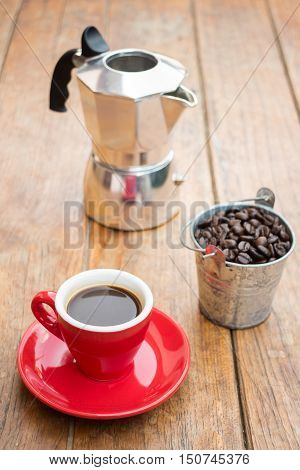 Red cup of espresso on wooden table stock photo