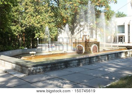 fountain Sanatorium .Ukrayina streams of fountain in Water stream pouring from fountain. Fountain water splashing on water surface of park lake. Fountain in summer park.