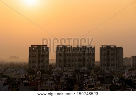 Dawn over gurgaon delhi showing the buildings in various stages of construction. The development of the city has led to a boom in infrastructure projects