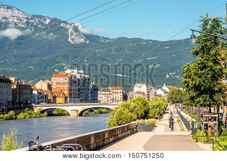 Morning cityscape view with mountains, river and promenade in Grenoble city on the south-east of France