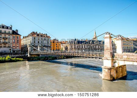Morning cityscape view with river and bridge in Grenoble city on the south-east of France