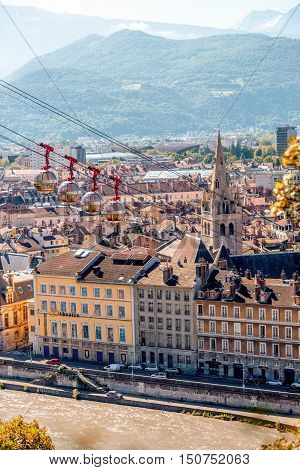 Grenoble, France - June 21, 2016: Morning cityscape view on the old town with cable car and mountains in Grenoble city on the south-east of France