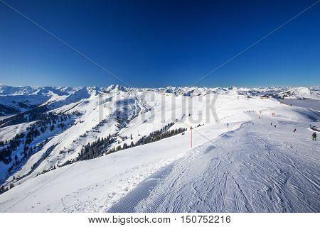 View To Alpine Mountains And Ski Slopes In Austria From Kitzbuehel Ski Resort - One Of The Best Ski
