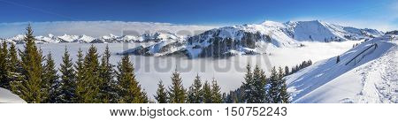 Panoramaview To Ski Slopes And Skiers Skiing In Kitzbuehel Mountain Ski Resort With A Background Vie