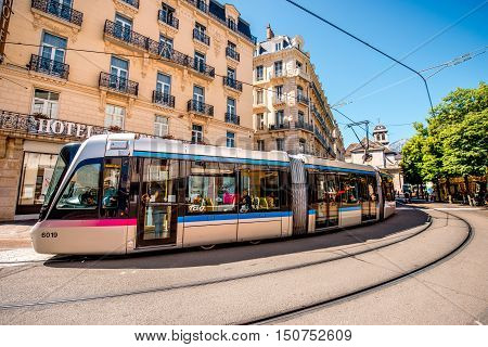 Grenoble, France - June 21, 2016: City street view with a new tram in the old city center of Grenoble city in France. Public transportation in Grenoble