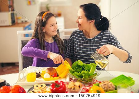 Mother making breakfast for her children in the morning and a snack for school at home