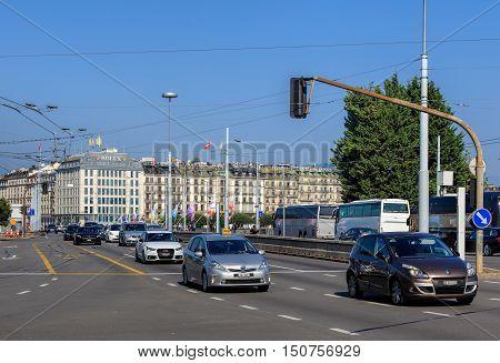 Geneva, Switzerland - 24 September, 2016: traffic on the Pont du Mont-Blanc bridge. Geneva is the second most populous city in Switzerland and is the most populous city of Romandy, the French-speaking part of Switzerland.