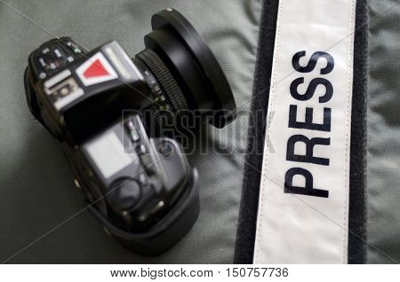 Press photographers bullet proof vest and professional camera