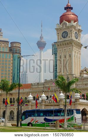 KUALA LUMPUR, MALAYSIA - January16. 2016: Clock tower of Sultan Abdul Samad building near Merdeka Square and the LK Tower in background.