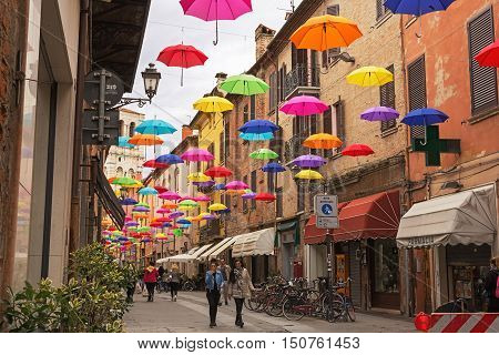 Ferrara Italy - May 02 2016: Umbrella sky in Ferrara Italy. The installation is set up in Mazzini Street and is visible from town square inviting people to follow in that direction. The aim of the installation is to highlight commecial activities in the c