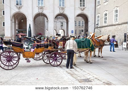 SALZBURG AUSTRIA - May 05.2012: Equestrian carriage for walks in the historical center of city on an Rezidentsplats Square