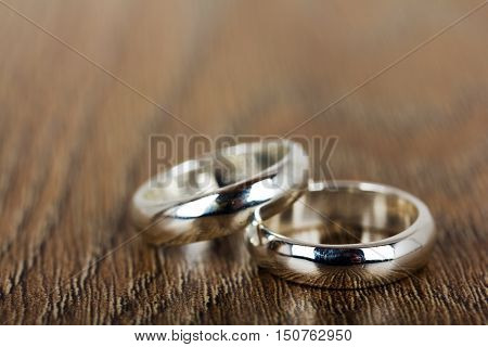 Pair Of Wedding Rings On A Wooden Background