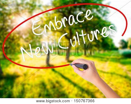 Woman Hand Writing Embrace New Cultures With A Marker Over Transparent Board