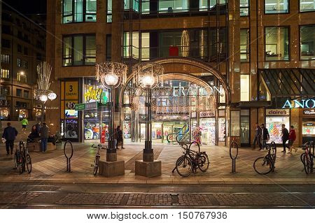 GENEVA, SWITZERLAND - NOVEMBER 18, 2015: Confederation Centre shopping mall at night. Geneva is the second most populous city in Switzerland, after Zurich.