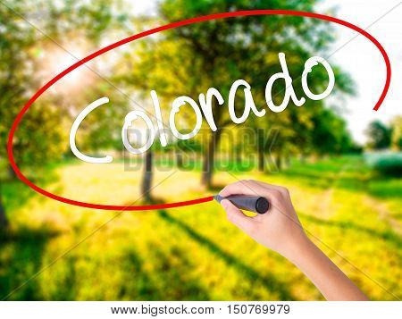 Woman Hand Writing Colorado  With A Marker Over Transparent Board