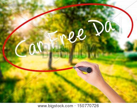 Woman Hand Writing Car Free Day With A Marker Over Transparent Board