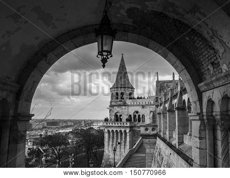 BUDAPEST HUNGARY - FEBRUARY 20 2016:Fisherman's Castle is a terrace in neo-Gothic and neo-Romanesque style situated on the Buda bank of the Danube in Budapest Hungary. Black and white.