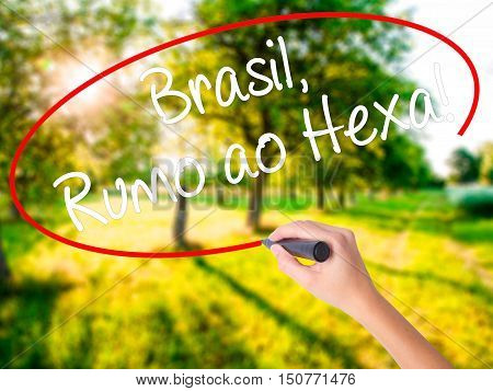 Woman Hand Writing Brasil, Rumo Ao Hexa! With A Marker Over Transparent Board .