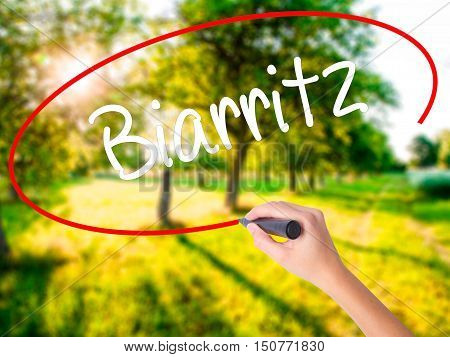 Woman Hand Writing Biarritz  With A Marker Over Transparent Board
