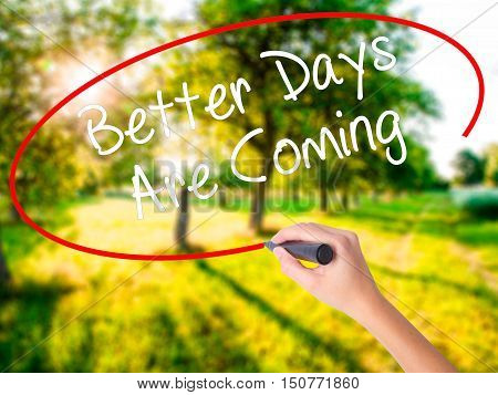 Woman Hand Writing Better Days Are Coming With A Marker Over Transparent Board .